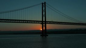 Sunset on the 25 de Abril Bridge in Lisbon. Timelapse stock video footage