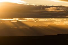 Sunset in the De Hoop national reserve, South Africa. Rays of sun streaking through clouds during sunset in the De Hoop national reserve, South Africa royalty free stock photo
