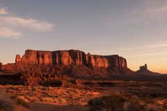 The Sunset in Death Valley. This picture shows the deep red colour of the sunset against the Sedona Monument Valley rock formation face, the sky is quite clear royalty free stock photo
