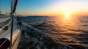 Sunset from the deck of the sailing boat moving in a sea. Travel. Royalty Free Stock Photos