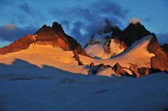 Sunset on the Dents de Bertol. Sunset on the glacier and peaks of the Dents de Bertol (3500m) in the Swiss Alps Stock Photography