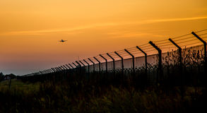 Sunset departure. Photograph of a plane departing from El Prat airport, Barcelona, Spain Royalty Free Stock Photos