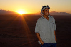 Sunset in the desert. Egypt, near to Hurghada, local camel and horse riding instructor smiling in the desert when the sun sets Royalty Free Stock Photography