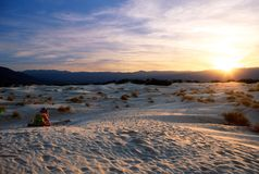 Sunset in the Desert. Gorgeous sunset in the Death Valley desert watched by a solitary young lady Royalty Free Stock Image