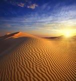 Sunset in desert Stock Images