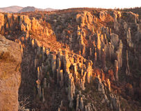 Sunset on Desert Cliffs. Setting sun lights up the Hoodoo rock formations that form the pinnacles and cliffs at Chiricahua National Monument, Arizona Royalty Free Stock Photo