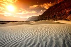 Sunset at desert Stock Images