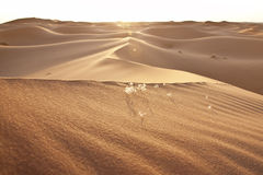 Sunset and desert sand dunes. In the Sahara Stock Photo