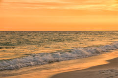 Sunset at Destin Beach Florida USA in Warm Brilliant Tones. Sunset at Destin Beach Florida USA in warm brilliant colors of orange, yellow, brown and green. This Stock Images
