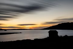 Silhouette of boat house, Devoke Water, Sunset
