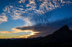 Sunset diff. Spindrift clouds during amazing sunset in mountains, Ukraine royalty free stock photography