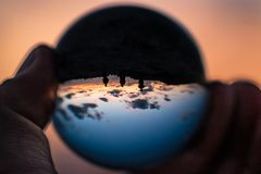 Sunset with a difference three people in Globe stock photos