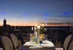 Sunset dinner table setting stock photography