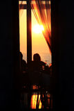 Sunset at dinner time. People watching the sunset and the ocean at dinner time in restaurant near beach Royalty Free Stock Photo