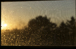SUNSET THROUGH A DIRTY WINDOW Royalty Free Stock Images