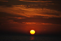 Sunset. Daily disappearance of the Sun below the western horizon as a result of Earth's rotation stock photo