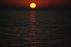 Sunset. Daily disappearance of the Sun below the western horizon as a result of Earth's rotation stock images