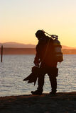 Sunset dive. A guy getting ready for a sunset dive Royalty Free Stock Photography