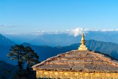 Sunset on Dochula Pass with Himalaya in background - Bhutan. In this pass, 108 memorial chortens or stupas known as Druk Wangyal Chortens have been built by royalty free stock photos