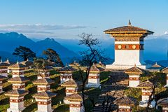 Sunset on Dochula Pass with Himalaya in background - Bhutan. In this pass, 108 memorial chortens or stupas known as Druk Wangyal Chortens have been built by stock photos