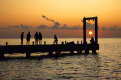Sunset dock. Boat dock shot at sunset with silhouetted people Stock Images