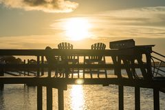 Sunset Over a Dock at the Beach stock image