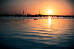 Sunset with Dock Stock Photo