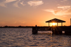 Sunset dock silhouette North Fort Myers Florida. North Fort Myers Florida sunset at the dock Stock Photo