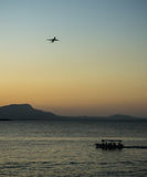Sunset in Dominican Republic. With a boat and a plane Royalty Free Stock Image