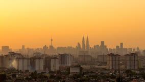 Sunset in downtown Kuala Lumpur. KUALA LUMPUR, MALAYSIA - 16TH APRIL 2015 : View of The Petronas Twin Towers during sunset on April 16, 2015 in Kuala Lumpur Stock Photography