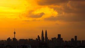 Sunset in downtown Kuala Lumpur. KUALA LUMPUR, MALAYSIA - 22TH FEBRUARY 2015 : View of The Petronas Twin Towers during sunset on in Kuala Lumpur, Malaysia Stock Image