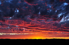 Sunset drama. Dramatic sunset painting clouds purple in Australia Royalty Free Stock Image