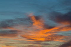 Sunset in dramatic blue sky with clouds in orange color tones Royalty Free Stock Photography