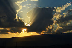 Sunset with dramatic clouds. Sunset time in the mountains with dramatic clouds and sun rays Royalty Free Stock Photography
