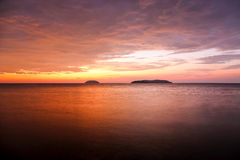 Sunset with dramatic clouds on the tropical beach Royalty Free Stock Photography