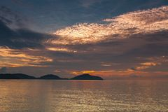 Sunset with dramatic sky ,clouds over mountain and andaman sea a Royalty Free Stock Photo