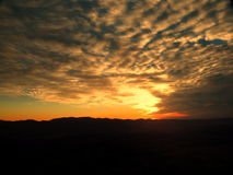 Sunset with dramatic sky Stock Images