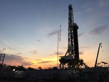 Sunset at drilling rig Stock Photography