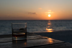 Sunset drink at the beach Stock Images