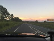 Sunset from a drivers perspective Stock Photos