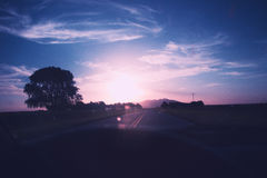 Sunset while driving on San Luis argentina. A beutiful sunset just hits your eyes while you`re driving on the country side of argentina cordoba and san luis road royalty free stock photography