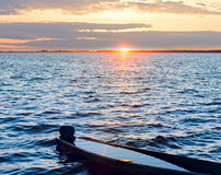 Sunset and drowned boat on summer lake bank Royalty Free Stock Photos