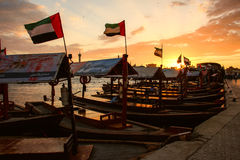 Sunset of Dubai Creek. This image was taken in Deira, Dubai during the sunset time. There are many Abrasboats stopped and waited for passengers. Abrasboats is Royalty Free Stock Images