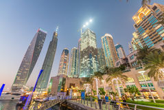 Sunset in Dubai Marina. Buildings reflections over artificial ca Royalty Free Stock Photos