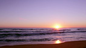 Sunset at Dunas Douradas beach seascape, destination in Algarve, Portugal. stock video footage