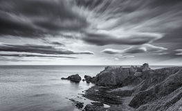 Sunset at Dunnottar Castle on the Scottish coast cloud in black Royalty Free Stock Images