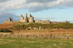 Sunset at Dunstanburgh castle Royalty Free Stock Photos
