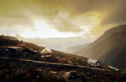 Sunset at Dzuluk village, with yellow clouds, Dzuluk, Sikkim. Sunset at Dzuluk village, Sikkim Stock Images