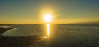 Sunset in the ebro delta by the sea. Spain royalty free stock image