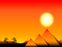Sunset in Egypt. With pyramids and palms Stock Photography